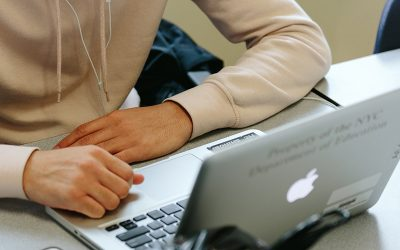 View of student sitting in front of laptop.