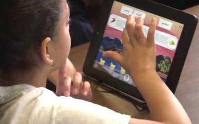 Photo of student working on her tablet device