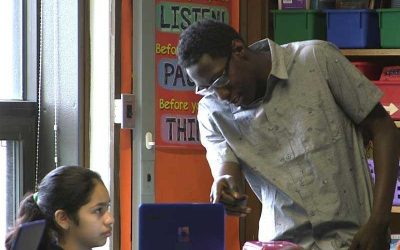 Photo of student and teacher working together on laptop