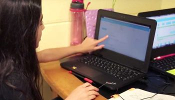 Photo of student working on her laptop
