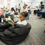 Photos of students engaged in a variety of learning activities based on their choice such as reading or practice on devices