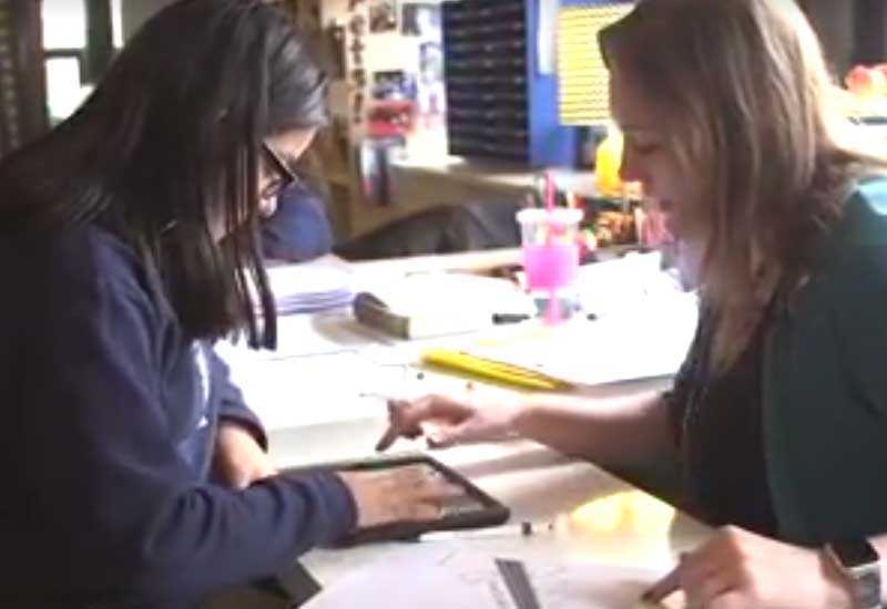 Photo of teacher and student in conference using tablet device
