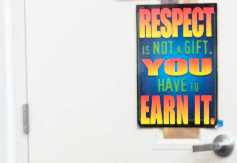 Photo of poster reading Respect is not a Gift, You have to earn it