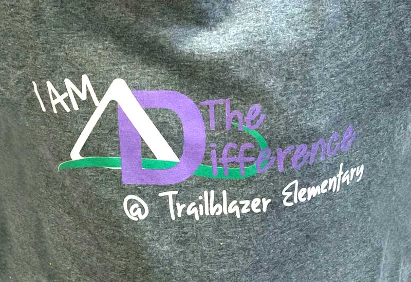 "Gray T-shirt that reads ""I am the difference at Trailblazer Elementary"""