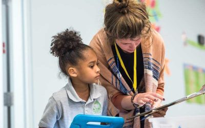 Photo of teacher and student working one-to-one