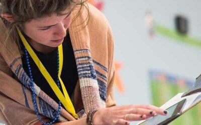 Photo closeup of teacher analyzing data on tablet screen